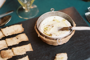 Roasted Camembert and crackers on a serving tray
