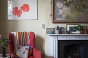 Furniture, textiles, and artwork gifted from friends and family or collected on their travels adorn this family room.