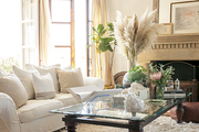 A neutral white-on-white living room