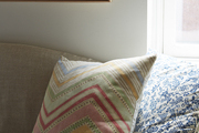 Patterned throw pillows atop couch