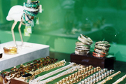 Jewelry on display against a green background