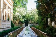 A long table is set of a Bastille Day dinner party in Charleston, South Carolina