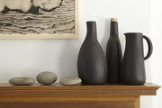 An array of stones and vessels echoes the palette in a print by artist Michael Balog.