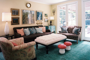 A pattern-filled family space with an ottoman as a coffee table