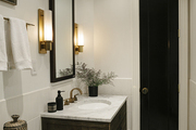 Marble counter top in black and white bathroom.
