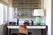 A contemporary brown and white work space with wall art.