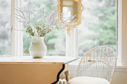 A vintage white chair paired with a drop-leaf table