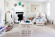 A white playroom with blue accents.