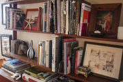 Shelves filled with books and art