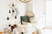 A cozy holiday corner with white textures.
