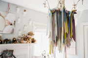A chandelier decorated with ribbon in a children's bedroom