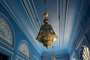 Fine detailing in a ceiling treatment with  gold pendant lighting in a Jaipur bar