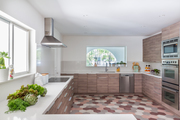 A neutral kitchen with a tiled floor.