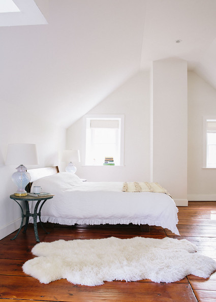 Sheepskin Rug - A cozy sheepskin rug in a serene master bedroom