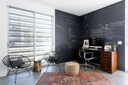 A contemporary workspace with a chalkboard wall.