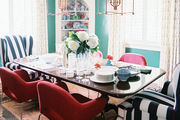 Striped wingback chairs in a dining space