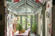 Tibetan prayer flags from a paragliding trip in the Himalayas are suspended between the kitchen and atrium.