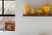 Yellow objects on open shelving.