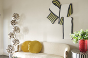 sitting room with vintage chaise and wall art