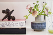 Details of poppies and a Keith Haring book  on a white shelf