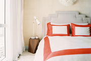 Red-and-white bedding in a neutral room