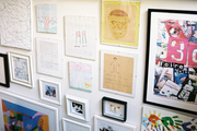 A gallery wall of art along a staircase