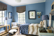 Blue-painted walls and brown curtains in a kids' room