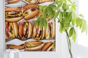 A large photograph of cheeseburgers situated above two dog bowls