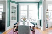A green and pink contemporary dining room.