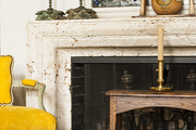 A rustic stone fireplace with eclectic wooden details