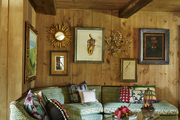 A wood-paneled living room.