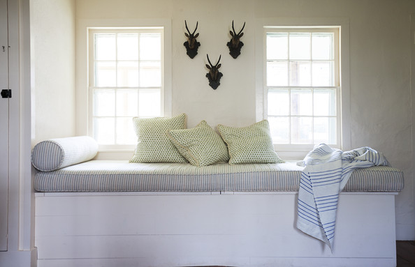 Window Seat - Striped upholstery on a window seat that adds extra storage in designer Michelle Smith's Sag Harbor house
