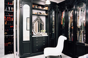 Built-in black cabinetry with storage for clothing
