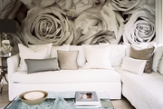 Wallpaper of large-scale roses paired with a white sectional