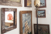 Framed horse and ocean paintings