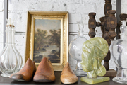 Vintage glassware, shoe lasts, and artwork at Buckingham Interiors + Design