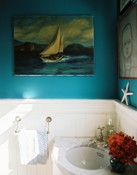 Vintage bathroom blue walls and nautical decorations in a bathroom