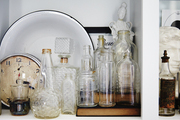 One of the bookshelf nooks houses a collection of vintage bottles that Ford found buried in her own backyard.