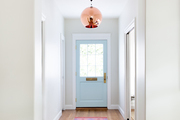 A view of a contemporary entryway with pink and blue accents.