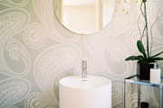 Paisley-print wallpaper in a minimalist bathroom space