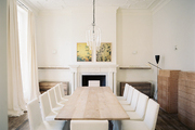 White chairs surrounding a wooden table