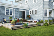 A back yard deck set for outdoor entertaining