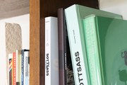 A bookshelf with a variety of books and colors.