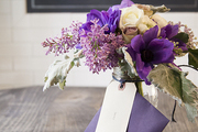 A spring bouquet of purple, gray, and white florals