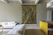 An antique map and modern sofas in a living room