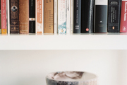 A marble bowl on a stack of books