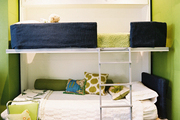 Shades of green, blue, and white in a children's room outfitted with bunk beds