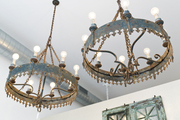 A pair of iron chandeliers at Buckingham Interiors + Design