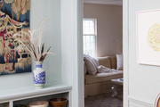 Subdued blue-green walls framing a restful dining room space
