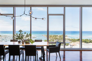 Contemporary dining room with a view of Honolulu.
